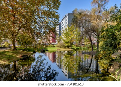 View of buildings in the city of Vigo, Spain, as seen from lake in Castrelos Park.