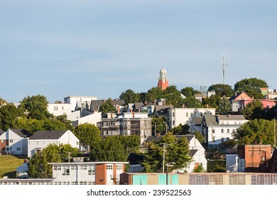 A view of buildings on hills in Portland, Maine from the sea