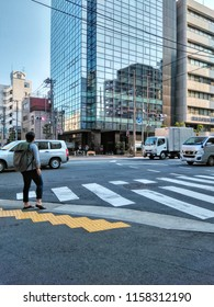 View to Buildings, People and Cars in the Streets of Tokyo in Japan 2018.