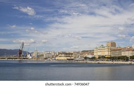 View at the buildings and port in Rijeka, Croatia from promenade in harbor