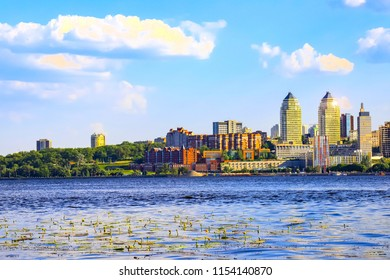 View of the  buildings and skyscrapers  on the banks of the Dnieper River in the Ukrainian city Dnipro  at sunset (Dnepropetrovsk, Dnipropetrovsk, Dnepr), Ukraine