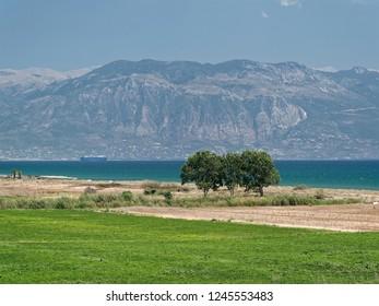 View from the Buka beach to Kalamata and Armiro Bay. Peloponnese. Greece.