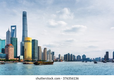 View from the Bund across the Huangpu River in Shanghai, China. The Shanghai Tower, the Shanghai World Financial Center (SWFC), the Jin Mao Tower and other skyscrapers of downtown are visible at left.