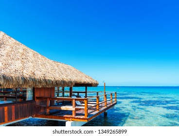 View of the bungalow in the lagoon Huahine, French Polynesia. Copy space for text