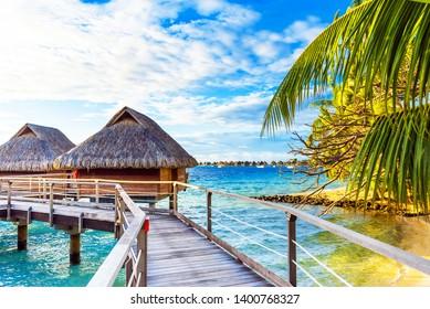 View of the bungalow on the sandy beach, Bora Bora, French Polynesia