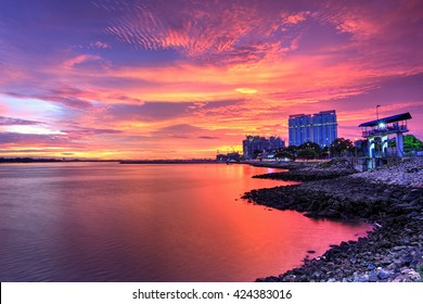 The view of burning cloud over Danga Bay,Johor Bahru, Malaysia with constructionbackground during sunset