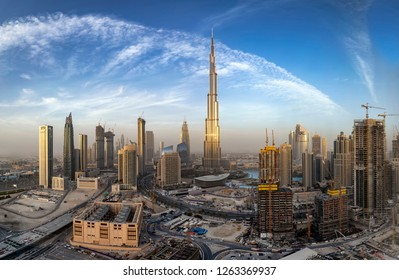 View to the Business bay of Dubai skyline with the golden shining skyscrapers during sunset time, UAE