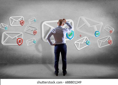 View of a Businessman in front of a wall with Approved email and spam message displayed on a futuristic interface - Message and internet concept