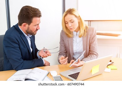View of a Businessman and his assistant working together at the office