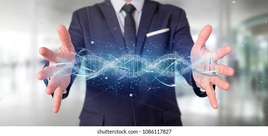 View of a Businessman holding a 3d render DNA