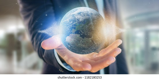 View of a Businessman holding a 3d rendering particles earth globe