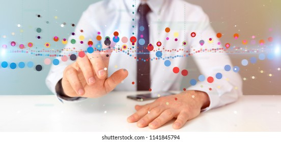 View of a Businessman holding a Business stock exchange trading data information