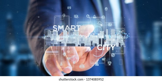 View of Businessman holding Smart city user interface with icon, stats and data 3d rendering