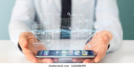 View of Businessman holding User interface screens with icon, stats and data 3d rendering