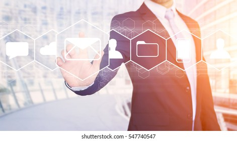 View of a Businessman touching technology interface with email icons