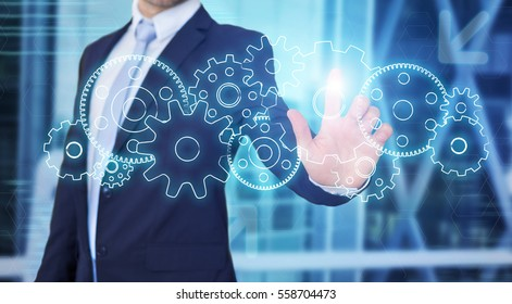 View of a Businessman touching technology interface with gear wheel setting
