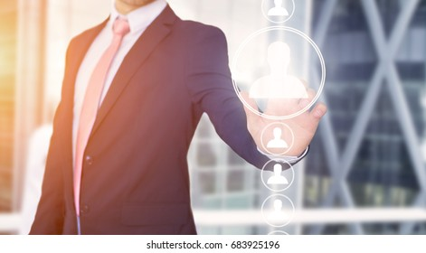 View of a Businessman touching technology interface with professional contact icon