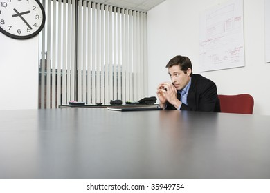 View of a businessman waiting in an office.