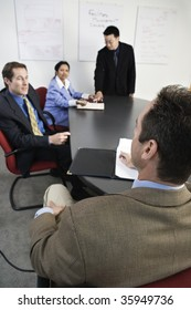 View of businesspeople in an office.