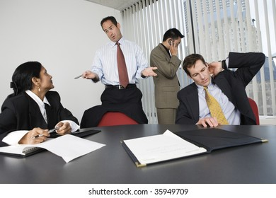 View of businesspeople in an office meeting.