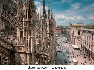 View of the busy Piazza del Duomo and the ornate architecture of the the Milan Cathedral Lombardy, Italy.