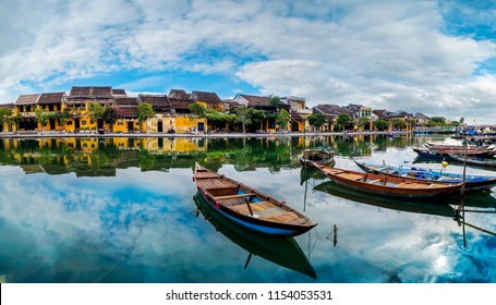 view of busy river in Hoi An, Vietnam. Hoi An is the World's Cultural heritage site, famous for mixed cultures and architecture.