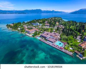 View by Drone - Aquaria in Sirmione, Garda Lake. spectacular view on lake, italian summer view aerial by Drone