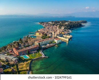 View by Drone - Castle Rocca Scaligera in Sirmione, Garda Lake. spectacular view on lake, italian summer view aerial by Drone