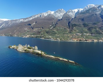 View by Drone - Isola di Trimelone, Garda Lake. spectacular view on lake, italian summer view aerial by Drone