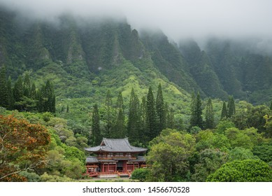 A view of the byodo-in temple and mountains covered in mist, shot from Temple of the Valley, oahu, hawaii.