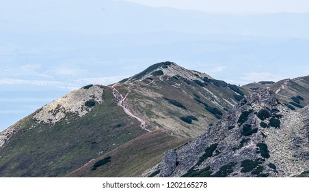 view from Bystre sedlo in Zapadne Tatry mountains on slovakian - polish borders during nice summer day with blue sky