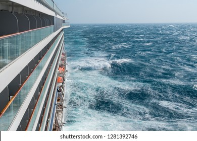 View from cabin balconies at the rough seas and waves off the side of cruise ship