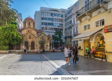View of cafe and Church of Panaghia Kapnikarea, Monastiraki District, Athens, Greece, Europe 12 October 2017