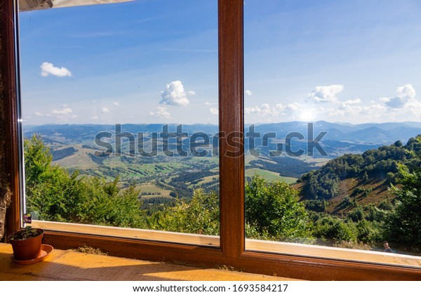 view from a cafe in the mountains window view from a window in the mountains mountains beautiful sky open spaces tourism outdoor activities in the mountains