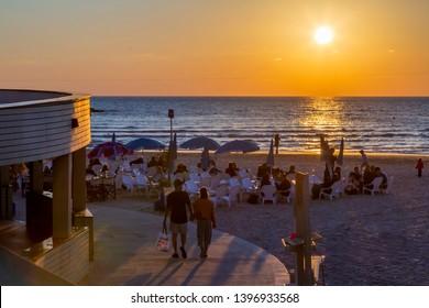 View of cafe restaurants on promenade at sunset, Hayarkon Street, Tel Aviv, Israel, Middle East 1-3-2019