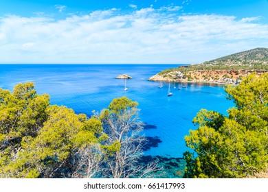 View of Cala d'Hort bay with beautiful azure blue sea water, Ibiza island, Spain