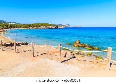 View of Cala Nova beach on sunny summer day, Ibiza island, Spain