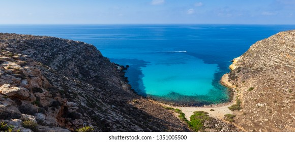 View of Cala Pulcino famous sea place of Lampedusa, Sicily