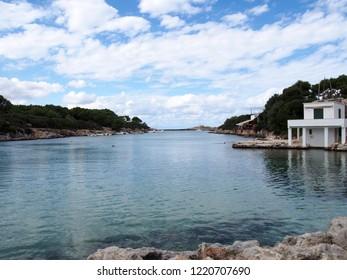 a view of Cala Santandria in a bright cloudy day in Menorca Spain