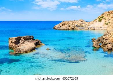 View of Cala Tarida bay with rocks in turquoise sea water, Ibiza island, Spain