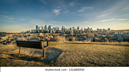 View of Calgary skyline with bench at foreground, Canada
