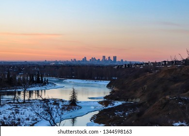 View of the Calgary skyline from fish creek provincial park in Alberta Canada. Sunset overlooking the Bow River with Downtown Calgary skyline in the background