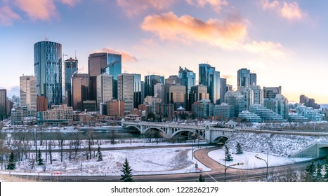 View of Calgary's skyline on a cool evening in winter. Bow river is visible in the foreground.