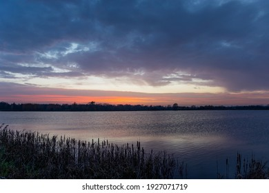 View of a calm lake and clouds after sunset, Staw, Lubelskie, Poland
