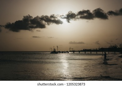 View of calm waters of Carlisle Bay in Bridgetown, Barbados, in the evening, unidentified boats on the horizon.