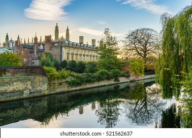 View of Cam river and the ornamented facade of Clare College at sunrise in Cambridge, UK