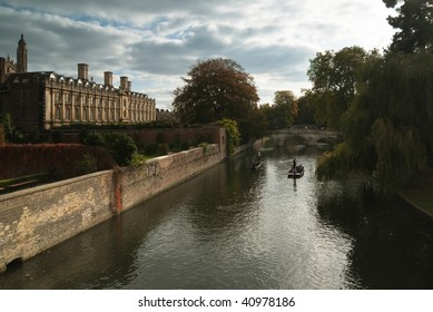 View of Cam river with ponters  and the ornamented facade of Clare College
