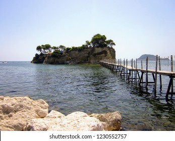View of Cameo Island at Zakynthos, Greece, Europe. Beautiful small island connected with Agios Sostis with wooden bridge. Lovers island, popular wedding place at Zante.