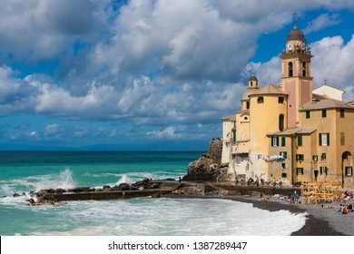 View of Camogli with its stormy sea in the Ligurian Riviera in Italy.