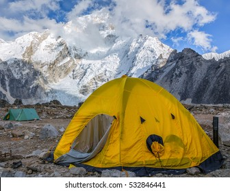 View of the camp of climbers on Khumbu glacier near near Gorak Shep village with Everest in the background - Nepal, Himalayas